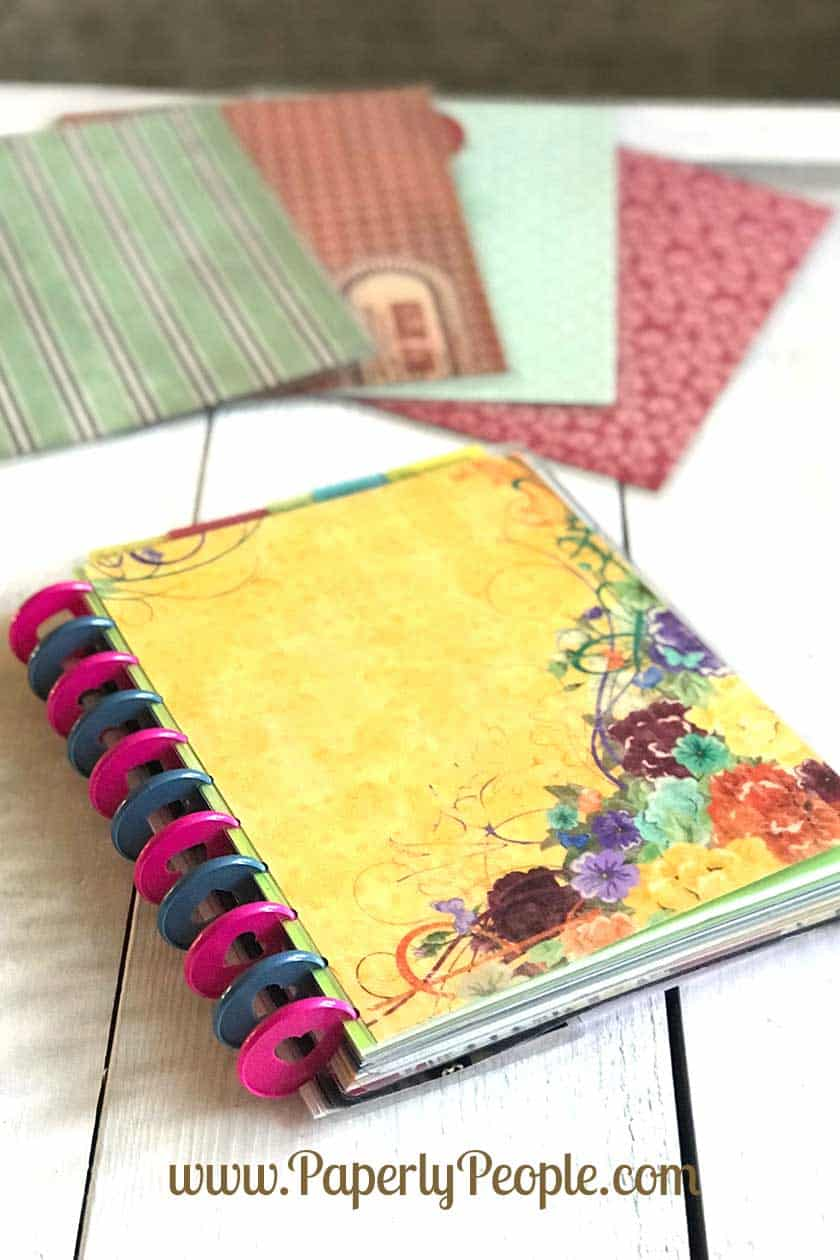 Scrapbook paper divider for 11 disc ARC planner. All my best tips and ideas for making a homemade planner divider using your scrapbook paper stash.