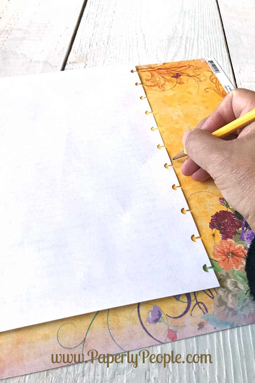 Outline the paper... Using scrapbook paper to make handmade DIY dividers for your disc bound planners.