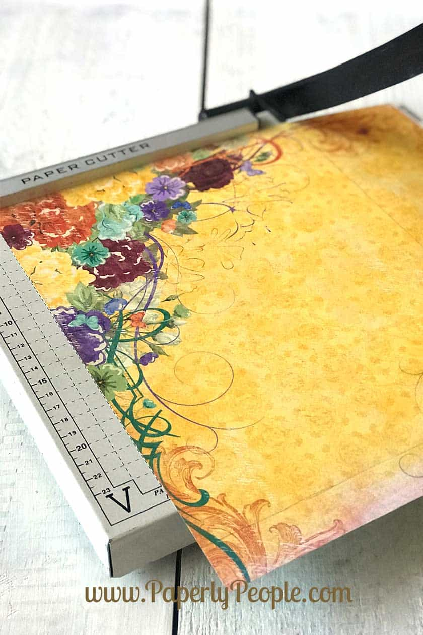 Use a paper cutter to cut your scrapbook paper... making dividers for your disc bound ARC planner. Tips and ideas for planner accessories.